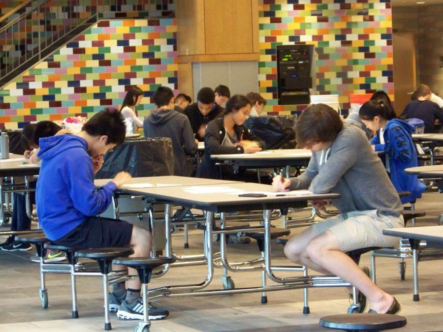 Members of the WHS math team answer arithmetic questions. The team will compete at the New England Championship Meet on Friday for the first time since 2014.
