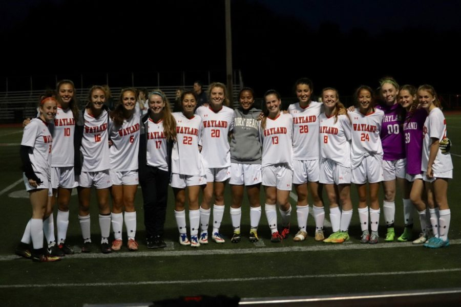 The varsity girls soccer team poses for a photo.