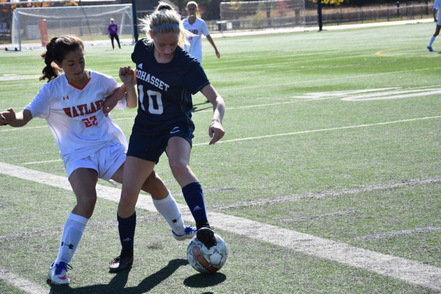 Junior Nicole Erdekian fights for the ball.