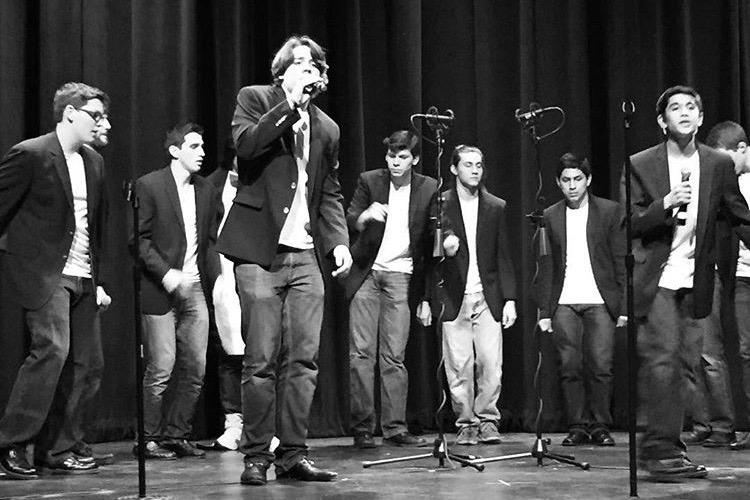 Pictured+above+is+Sid+Iyer+and+Zach+Knapp+singing+during+their+a+capella+concert.+Zach+and+Sid+are+both+directors+of+the+T-tones+a+cappella+group+at+the+high+school.+
