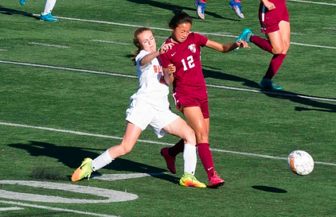 Pictured above is Poulsen fighting for the ball in her game against Arlington Catholic.
