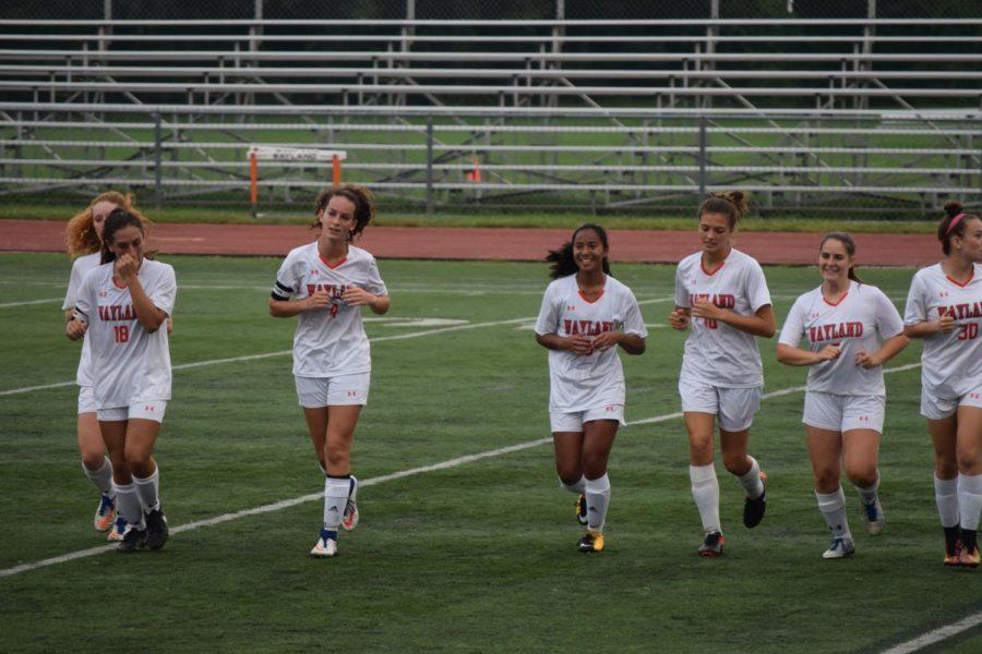 Pictured+above+are+members+of+the+girls%27+varsity+soccer+team+cooling+down+after+a+game.+They+defeated+top-seeded+Saugus+High+School+in+their+first+round+of+playoffs+on+Friday.+%22It+seemed+like+everyone+else+thought+we+had+no+chance%2C+but+we+knew+we+had+been+improving+all+season%2C+and+we+believed+that+the+statistics+didn%27t+define+the+two+teams%3B+what+really+mattered+was+how+we+played+on+the+field%2C%22+sophomore+Kayla+Poulsen+said.+
