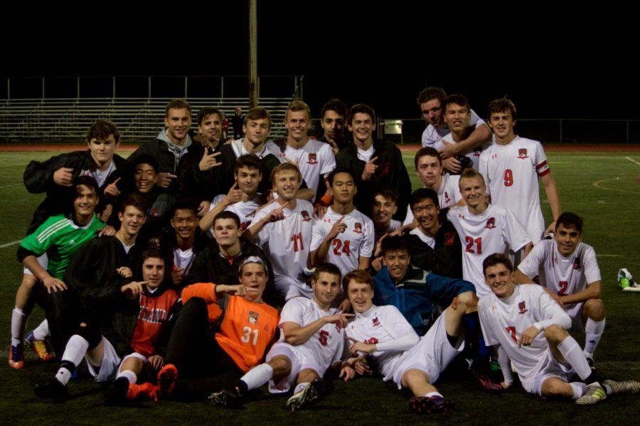 The boys' varsity soccer team poses for a photo after their win.
