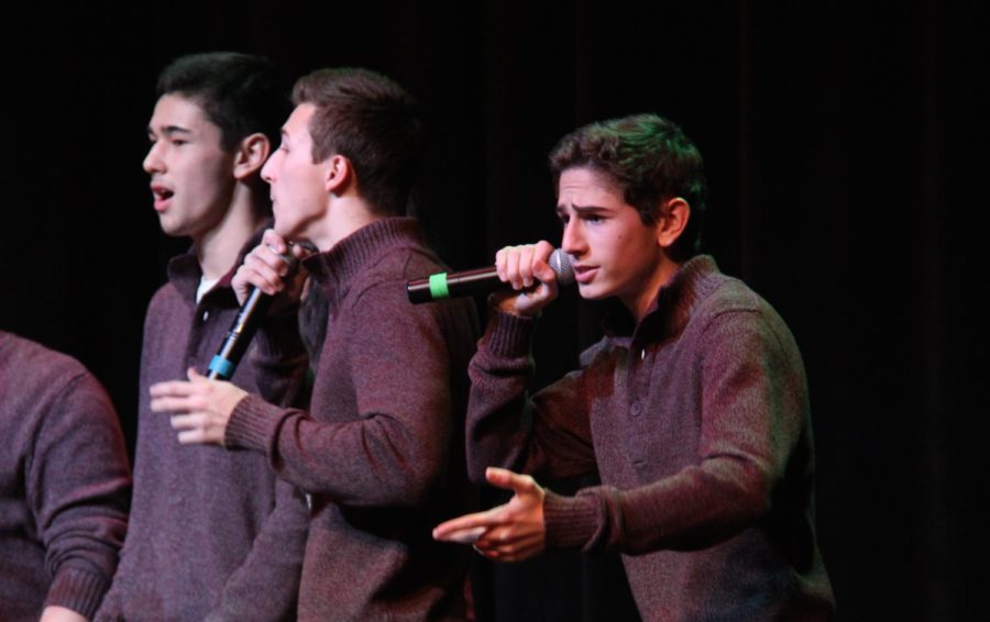 Pictured above is senior Logan Dawson singing at a cappellas 2016s Winter Week performance.  He is one of this years directors for the Madrigals.