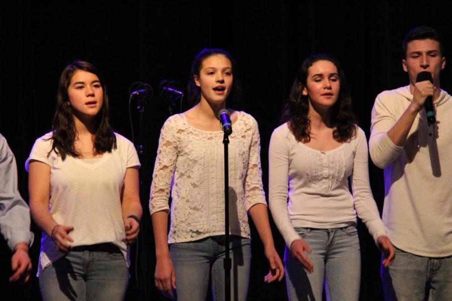 Senior Lilly Lin, junior Emma DiIanni, and junior Alexa Calder, singing in 2016's A Cappella Winter Week Concert.