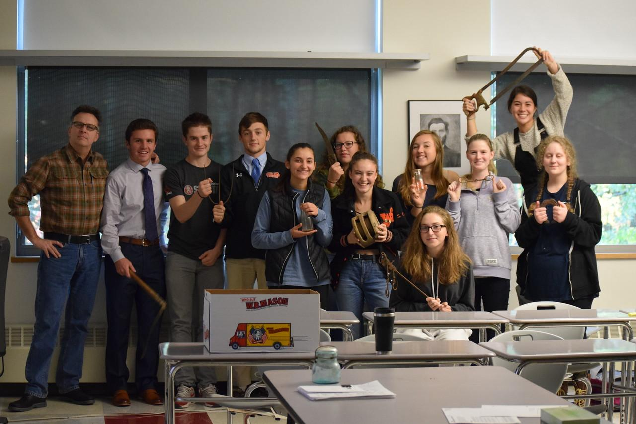 Pictured above is History department head Kevin Delaney and his class of 11 with tools from the past.