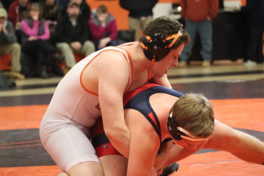 Senior Zach Goldstein grabs his opponent.