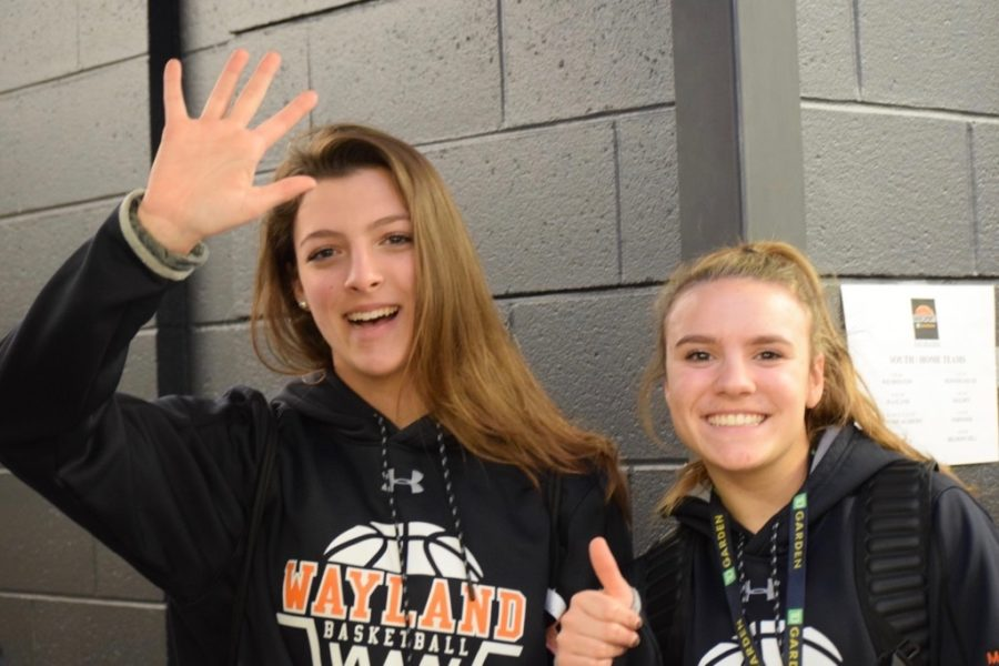 Junior Haley Rice (left) with her teammate Abi MacDonald. Rice is the manager for the girls' varsity basketball team this winter.