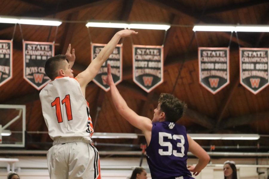 Peter Wolff shoots over a Boston Latin defender.