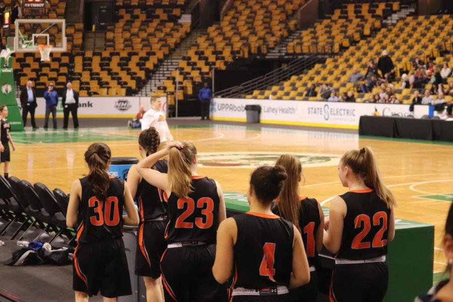 The+girls%27+varsity+basketball+team+walks+onto+the+court+before+the+game.