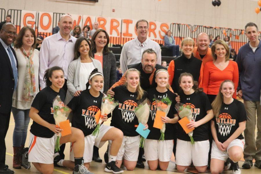 The seniors and their families during the Senior Night ceremony.