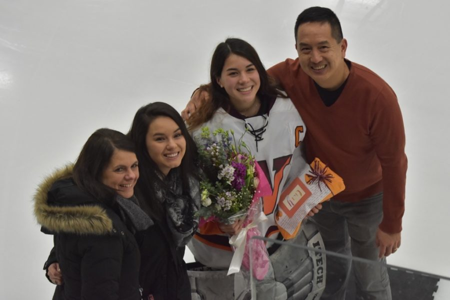 Senior captain Lilly Lin poses with her family.