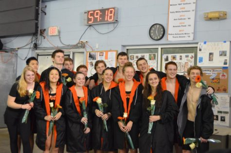 The Swim and Dive Team faces Norwell during Senior Night