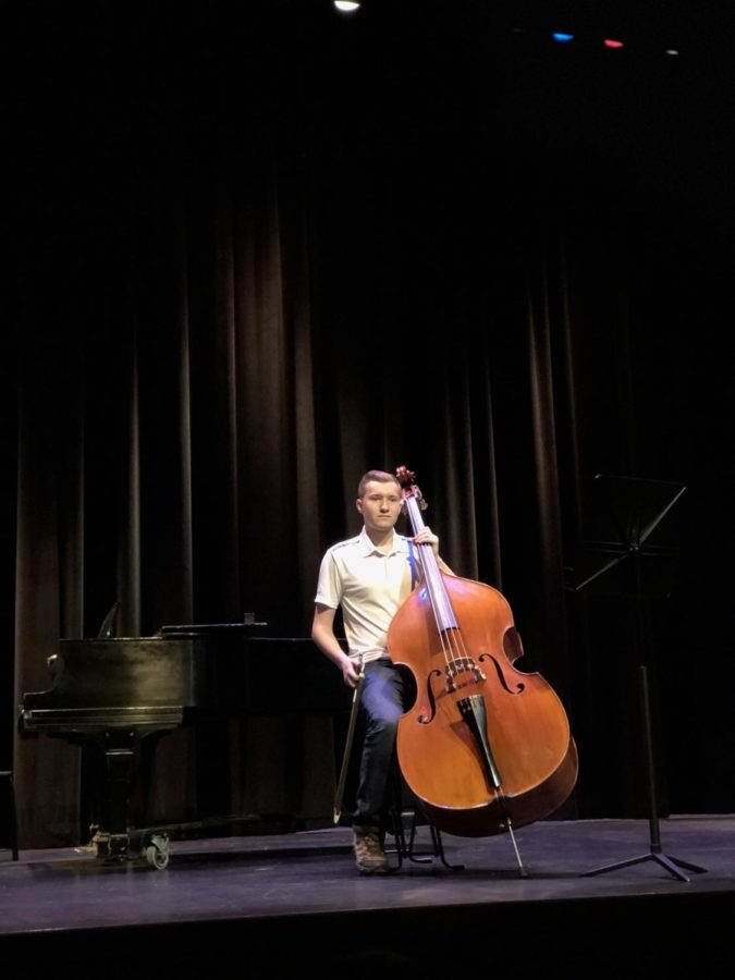 Pictured above is senior Dylan Rader performing a solo on his bass.