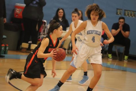 Girls' basketball falls to Medfield (30 photos)