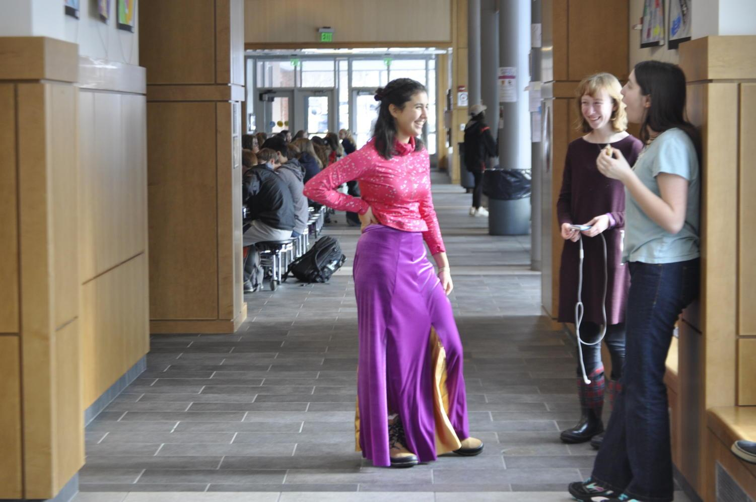Pictured above is junior Teresa Hank Gomez, alongside her stylist Renée Case, trying on part of her newly made prom dress.
