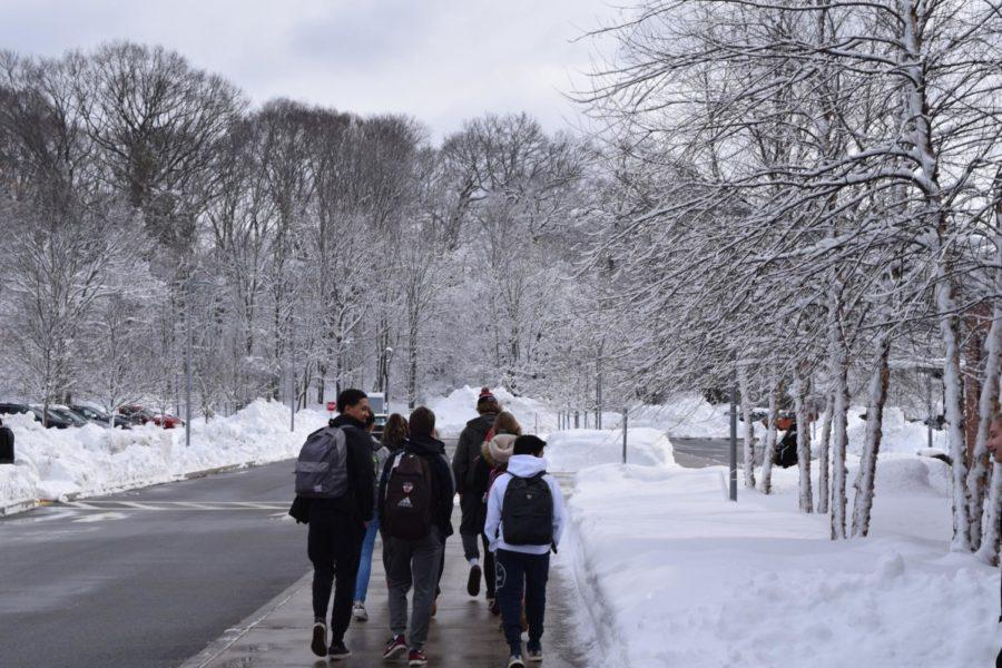 Students+walk+in+the+snow.+WPS+Superintendent+recently+announced+a+two-hour+delay+to+school+start+times+tomorrow%2C+with+the+potential+for+a+full+cancellation+by+5%3A15+a.m.+on+Tuesday+morning.
