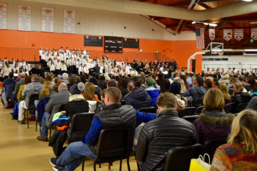 The crowd watches middle schoolers perform.