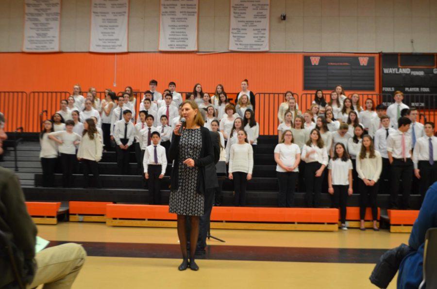Fine arts director Susan Memoli introduces the performers.