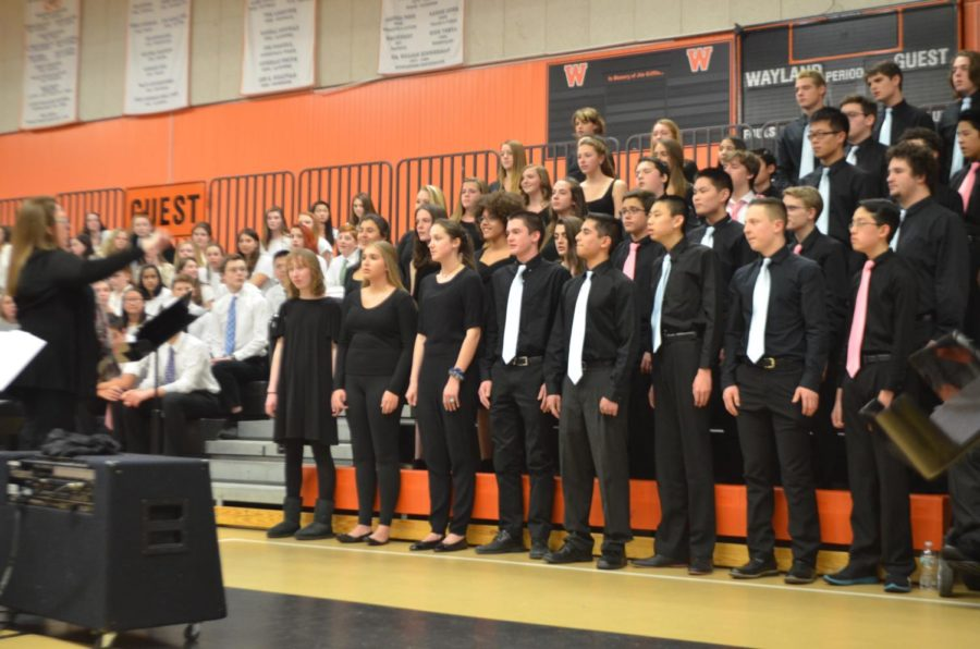 The Wayland High School Chorale and Concert Choir, directed by Rachel Carroll, sing