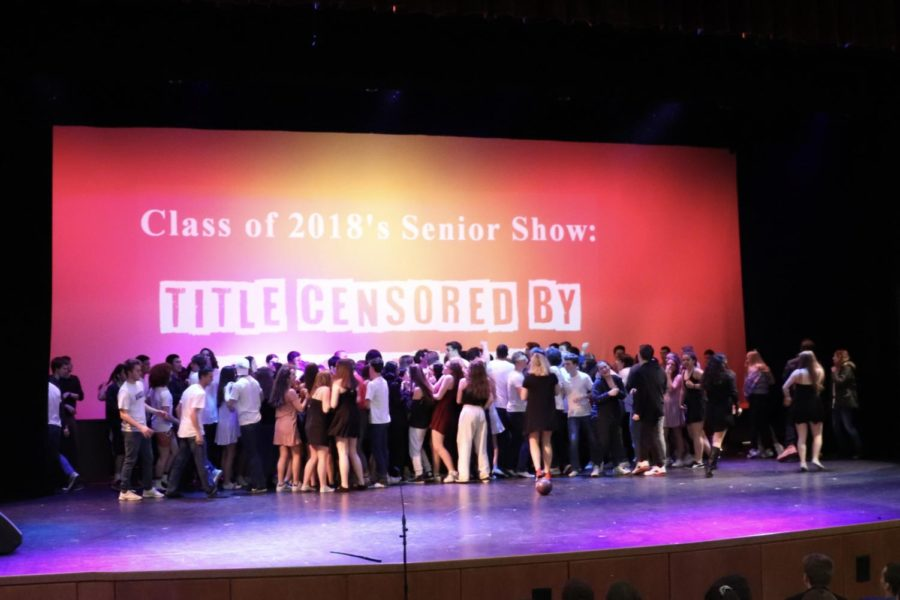 The class of 2018 storms the stage at the end of the show, following their call to