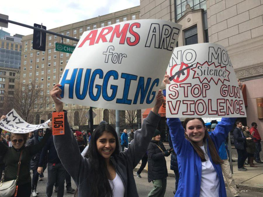 Anand and senior Gabi Smith hold signs during the march.