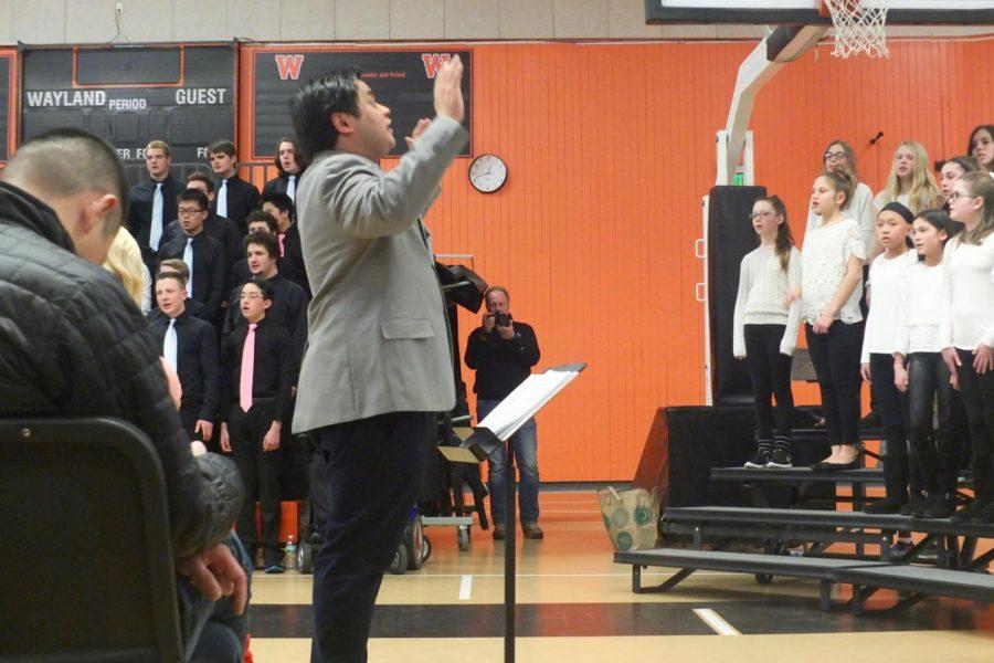 Guest director Benjamin Tan directs the Wayland Middle School sixth grade chorus.