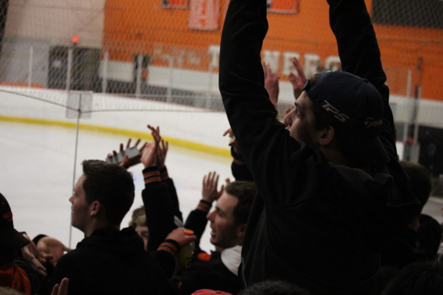 Pictured above are Wayland fans celebrating at a hockey game