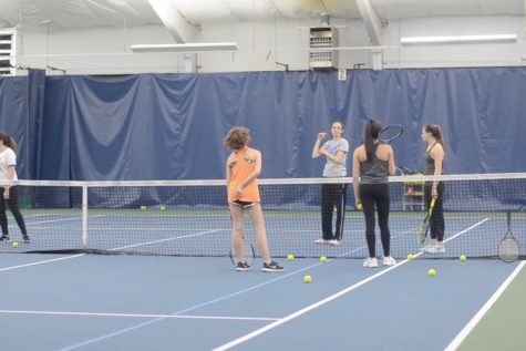 Girls' varsity tennis team swings into new season (video)