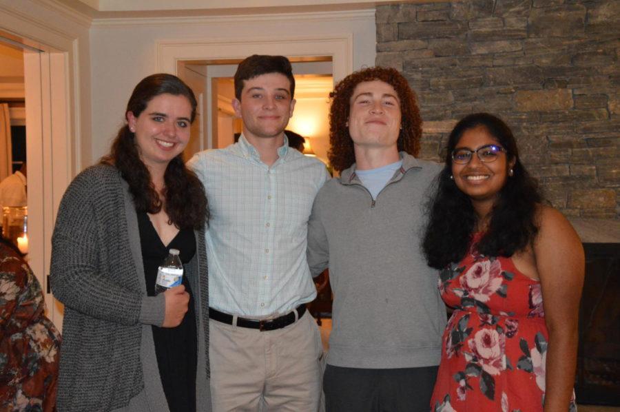 Gitten, Stephenson, Manny Oliver and Gandhi pose for a photo.