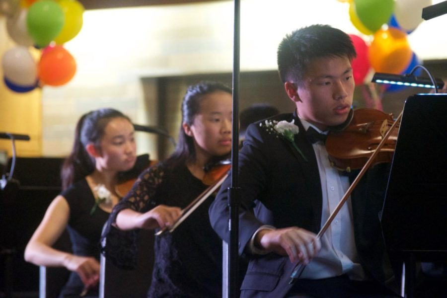 Zhong, Zhang and Hong focus on their music.