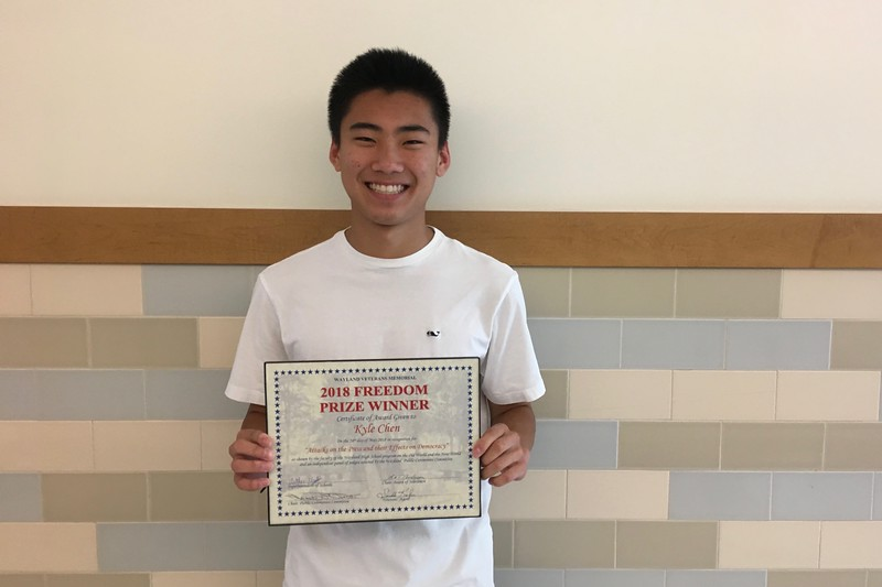 """Pictured above is sophomore Kyle Chen and his Freedom Prize plaque. Kyle won the 13th annual Freedom Prize Paper contest. """"I think that writing something that [can] have a profound effect on my community, [and] that people will actually read and think about has been an experience that has helped me grow and find my voice,"""" Chen said."""