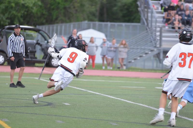 Senior Ben Travis cradles the ball.
