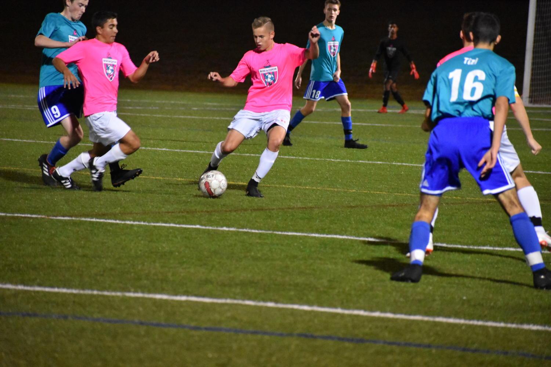 Freshman+Jackson+Dresens+dribbles+the+ball.