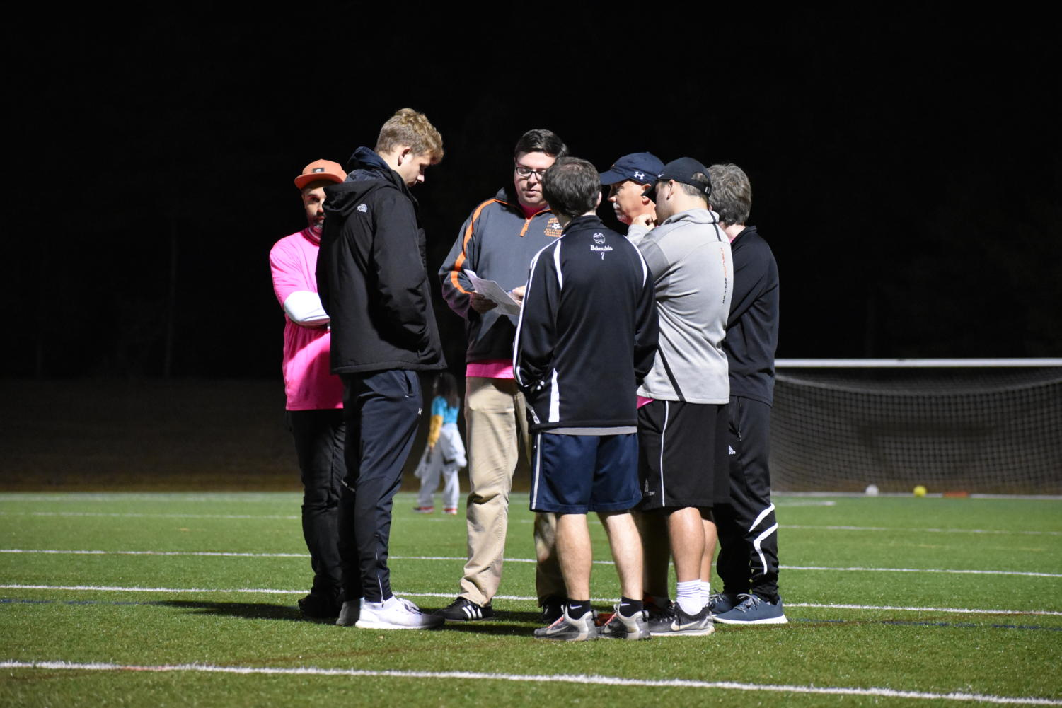 The+coaches+huddle+at+halftime.
