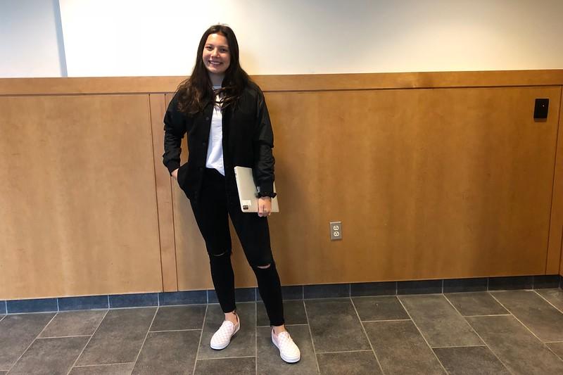 Junior Noelle Flanagan wears J.Crew, Vans, Vineyard Vines and Roots.
