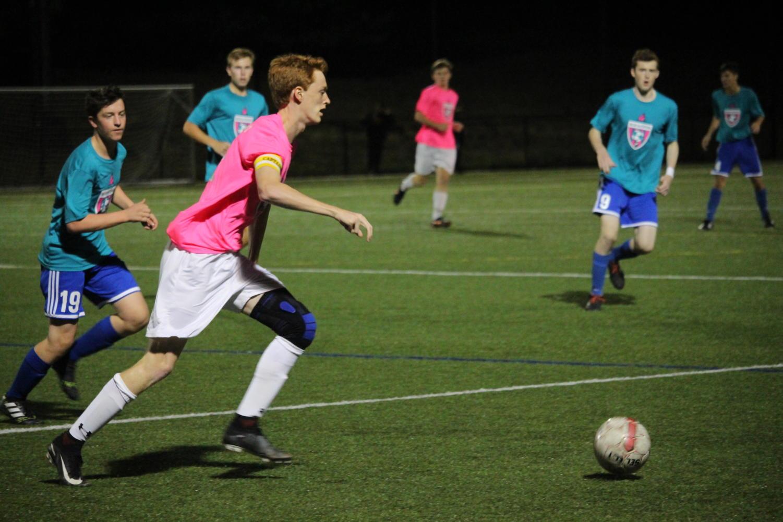 Senior+captain+Gage+Fuller+chases+the+ball+to+gain+possession.+