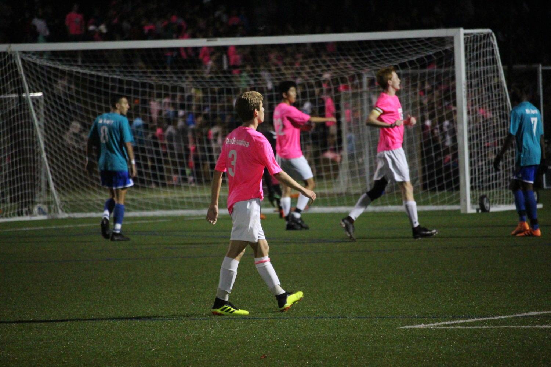 Sophomore+Zach+Campana+positions+himself+for+a+corner+kick.+
