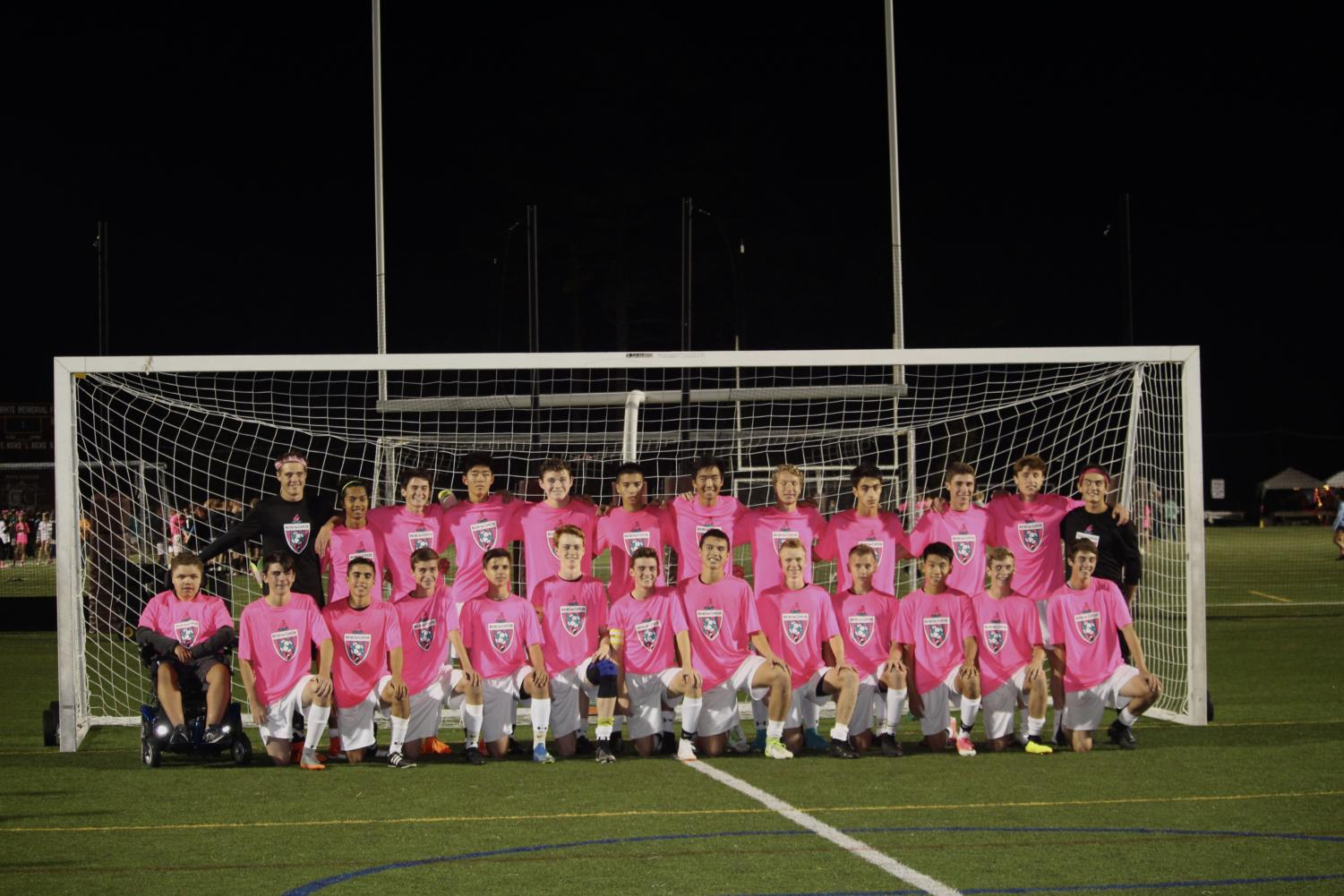 The+team+poses+for+a+picture+after+a+1-1+tie+against+Acton-Boxborough.