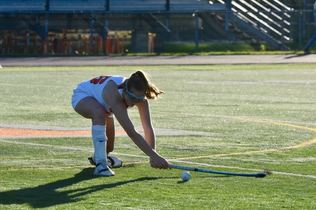 Senior+Lily+Tardif+sweeps+the+ball+into+the+offensive+end.+