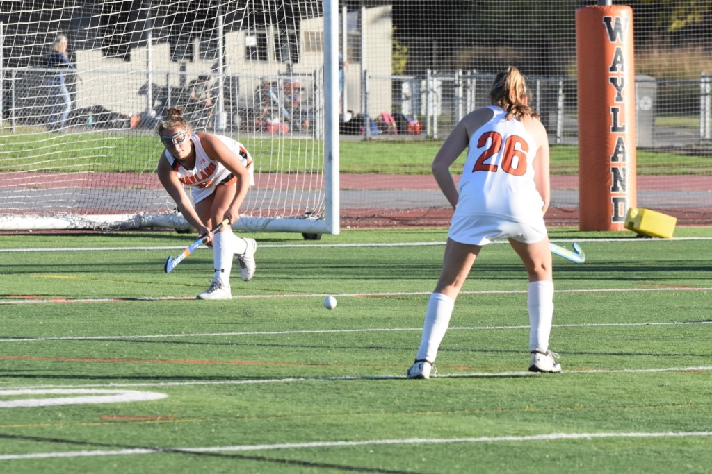 Miller+passes+the+ball+back+to+Tardif+to+set+her+up+for+a+shot.