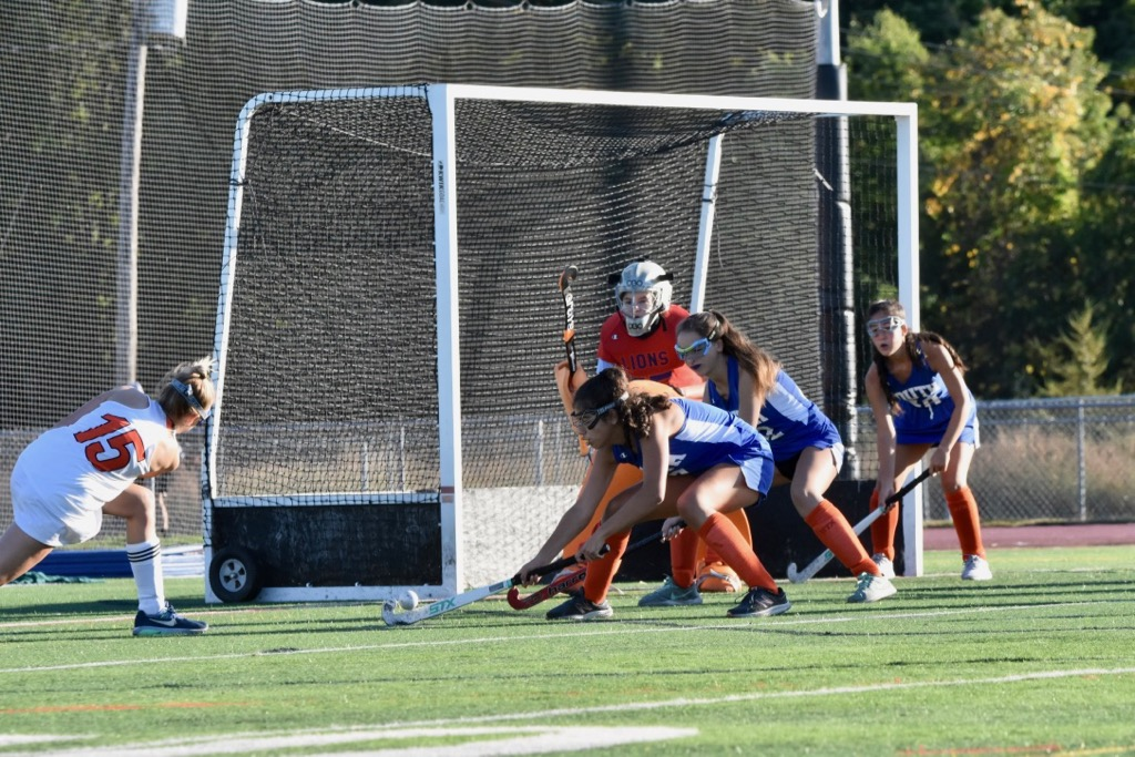 Senior+Olivia+Tacelli+takes+lunges+for+a+shot+at+the+Newton+South+goal.