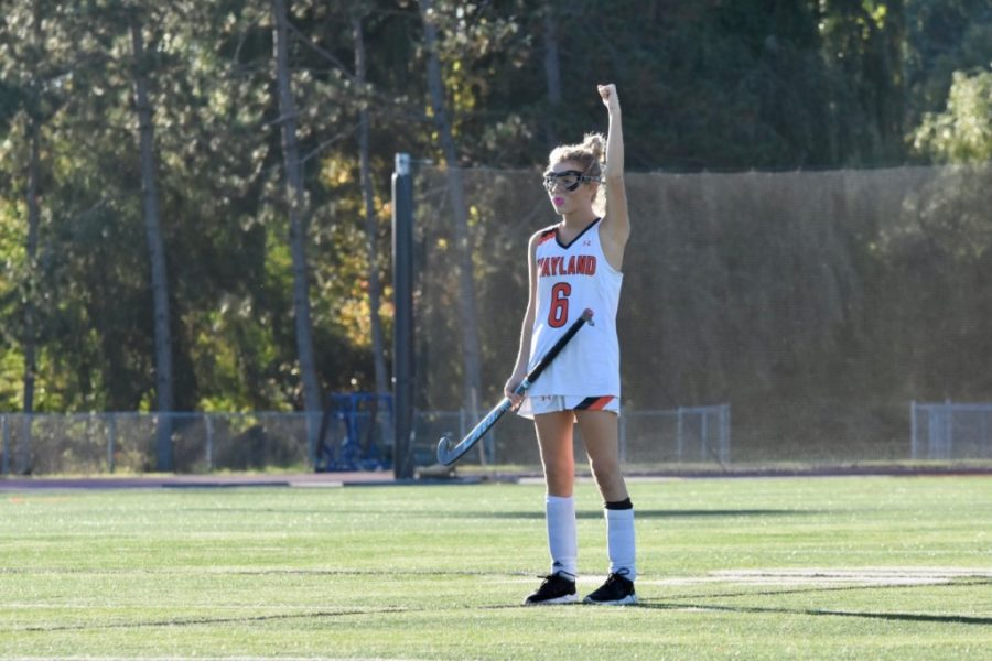 Senior Lauren Campbell lifts her fist in the air in celebration of a Wayland goal.