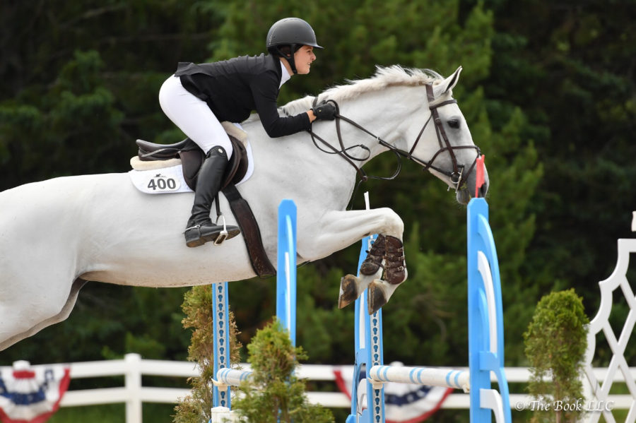 """Junior Isabel Mishara jumps her horse, Stella, at the Lake Placid Horse Show in 2018. Mishara has competed in shows and tournaments across the nation, ranging from New York to Vermont to Florida. """"If I've had a bad day, I enjoy going to the barn and riding,"""