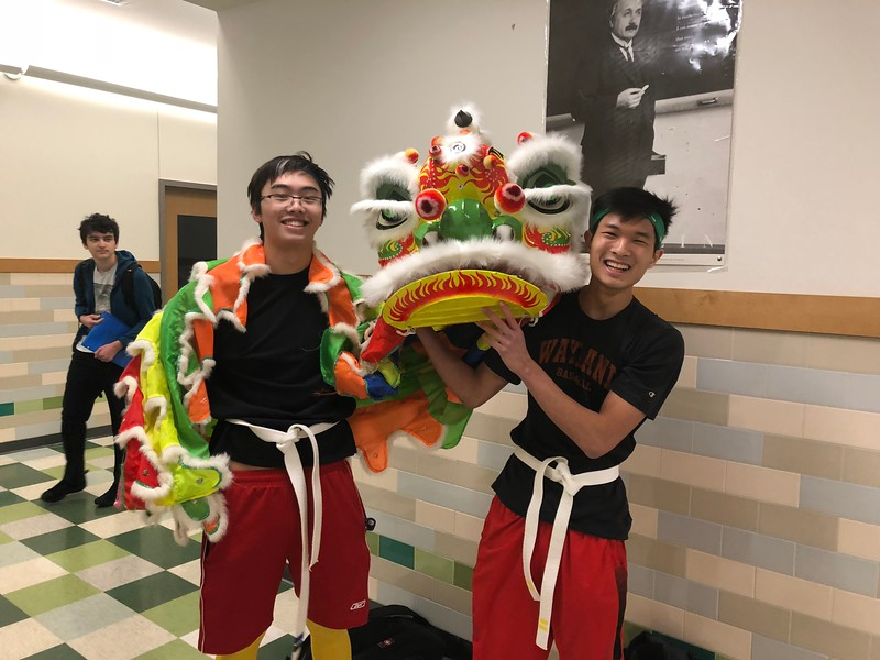 Seniors+Edmond+Giang+and+Alex+Kwan+pose+in+a+dragon+dance+costume+which+is+used+in+a+Chinese+New+Year+tradition.