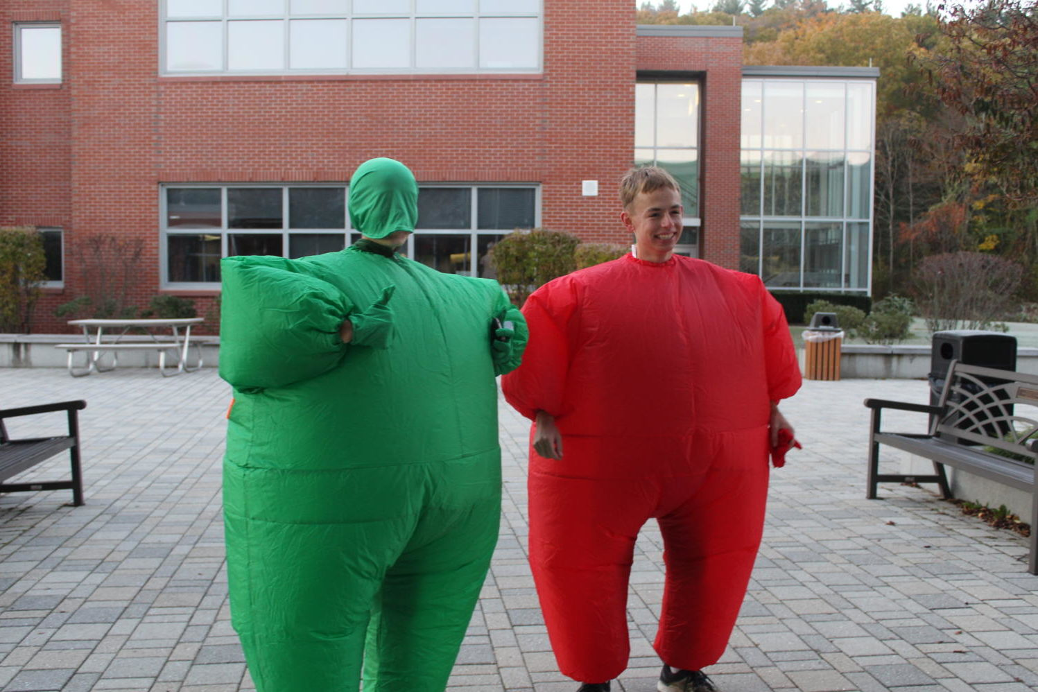 Megean+Walsh+and+Cory+Puckett+dress+up+in+red+and+green+%22fat+suits.%22