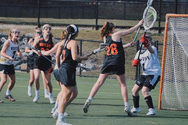 "Senior Lily Tardif shoots at the goal during an away game against Weston. Tardif has played lacrosse from a young age and will be playing Division 1 NCAA Lacrosse next year. ""I would always practice on the wall and shoot pretty much every single day because I was a crazy freshman who was obsessed with lacrosse,"