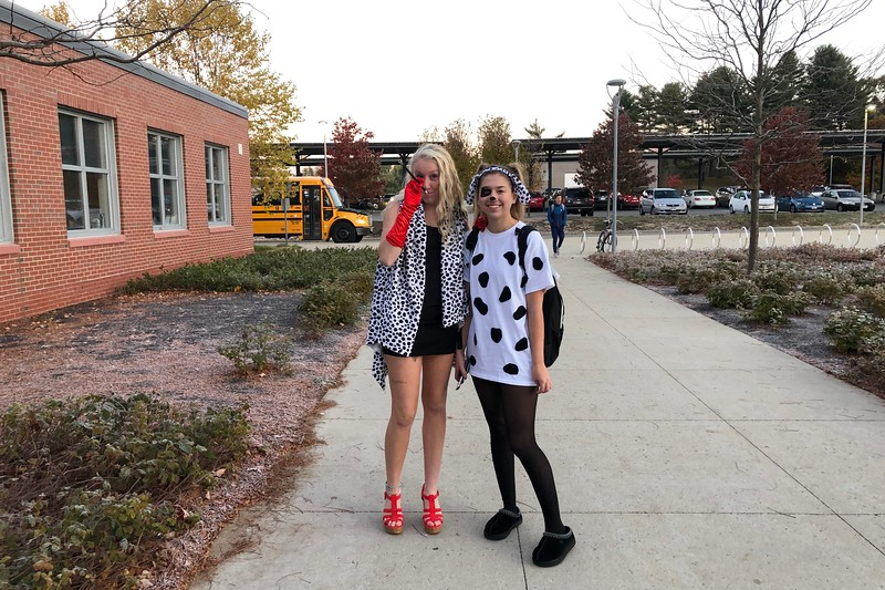 Julia+Nuss+and+Jillian+Stone+pose+next+to+one+another+dressed+as+Cruella+de+Vil+and+a+dalmatian.