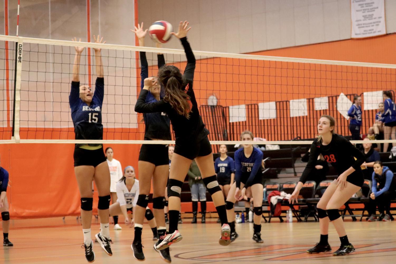 Senior+Ines+Alpendre+sends+the+ball+over+the+net.