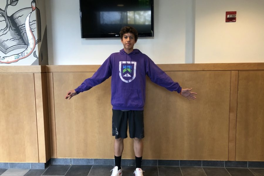 Junior Gavin Moser poses in Nike shorts and a sweatshirt from Savers.